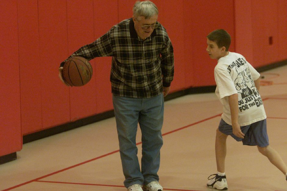 Dick Vinton returns the basketball to his grandson Mike Roth, 11, while they practice together at the Wallingford Recreation Department Jan. 23, 2001. Mike Roth goes to Holy Trinity School in Wallingford. Dick Vinton is visiting family from Maine.