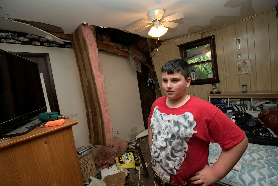 Giovanni Argo, 11, of Wallingford, talks about damage done to his bedroom from a fallen tree at 103 Pond Hill Rd. in Wallingford, Wednesday, May 16, 2018. Dave Zajac, Record-Journal