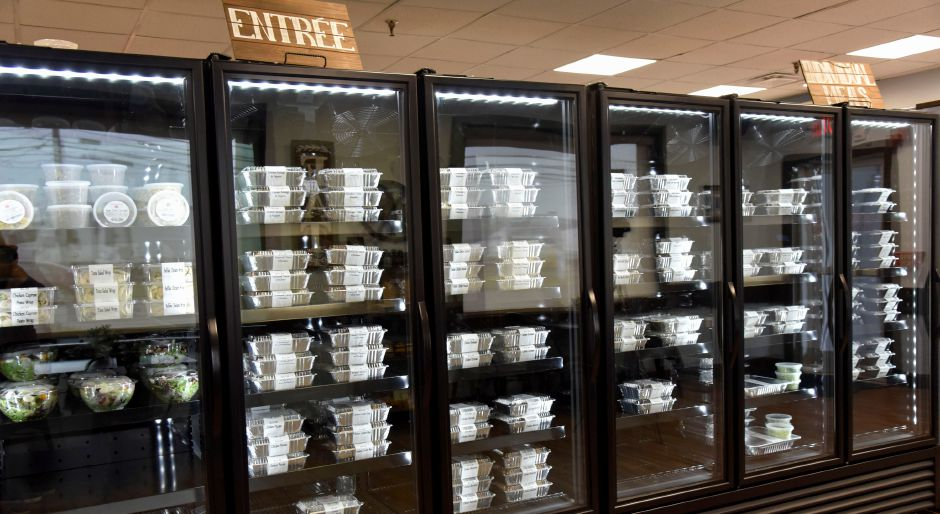 Coolers filled with a variety of to-go meals available at Perfectly Prepared, Gourmet to Go in Cheshire, pictured on Wednesday, August 28, 2019. | Bailey Wright, Record-Journal