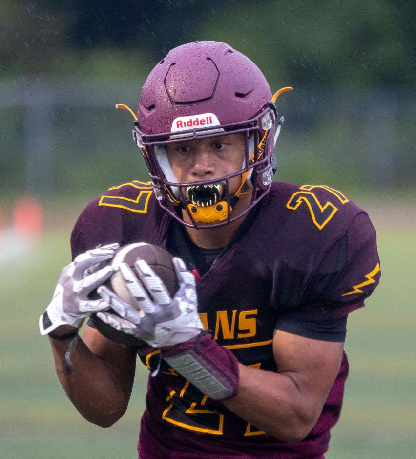 Sheehan's Jordan Davis heads for the end zone after snagging a pass from quarterback Kyle Simmons during Friday's scrimmage with North Branford. Davis will be a main cog for the Titans as a receiver, running back and outside linebacker. |  Aaron Flaum, Record-Journal