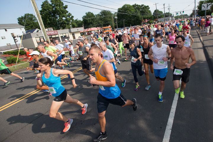 FILE PHOTO: Runners and walkers make their way down East Street from the start Sunday during the GE 5 K Petit Road Race to benefit the Petit Family Foundation in Plainville Jul. 17, 2016 | Justin Weekes / For the Record-Journal