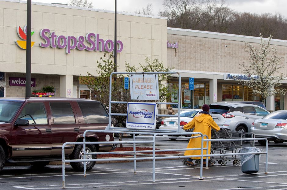 A Stop & Shop employee works on gathering shopping carts at the Meriden store on Centennial Avenue. Thursday, April 9, 2020. Aaron Flaum, Record-Journal
