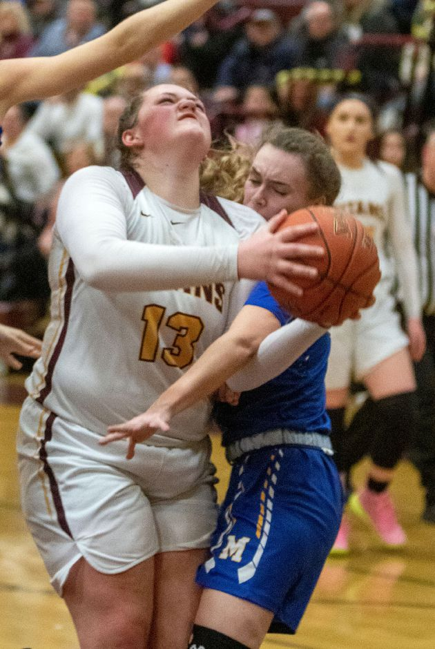 Sheehan's Caitlyn Hunt gets fouled by Mercy's Lilly Hedge as she goes to the basket during the first half at Sheehan High School on Friday, February 14, 2020. Aaron Flaum, Record-Journal
