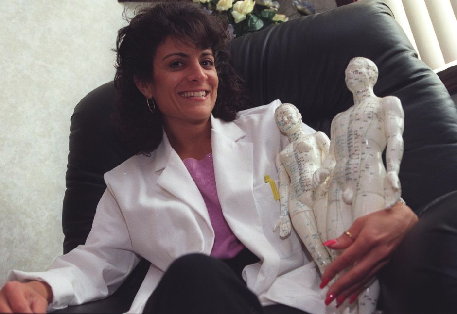 RJ file photo - Dr. Raya poses with a couple acupunture models in her office at Advanced Back Center at 196 Queen Street, June 19, 1999.