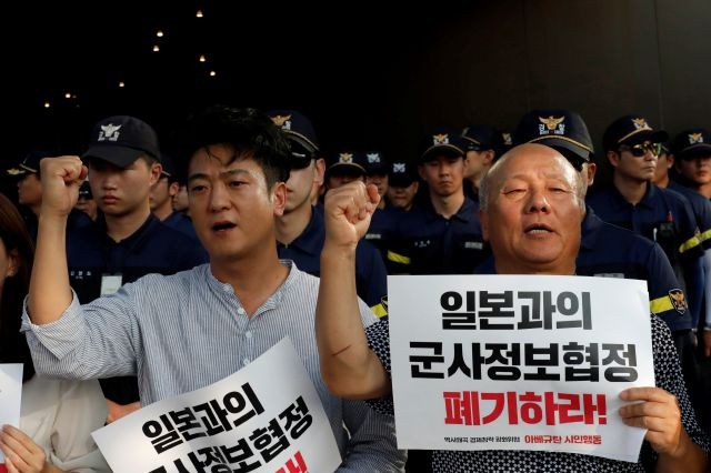 "South Korean protesters shout slogans during a rally demanding the South Korean government to abolish the General Security of Military Information Agreement, or GSOMIA, an intelligence-sharing agreement between South Korea and Japan, in front of Japanese embassy in Seoul, South Korea, Thursday, Aug. 22, 2019. The letters read ""Abolish the General Security of Military Information Agreement, or GSOMIA. (AP Photo/Lee Jin-man)"