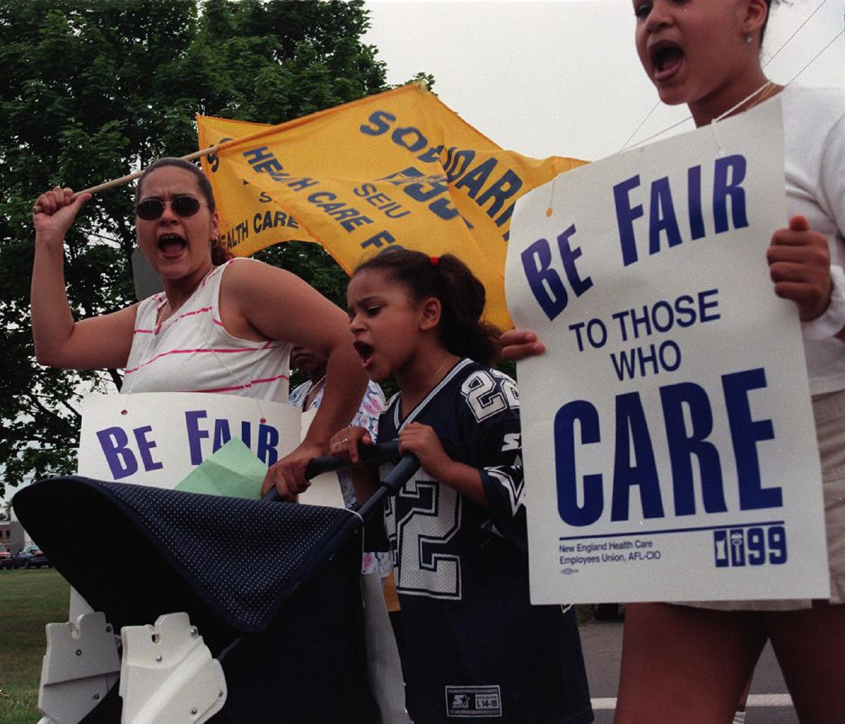 Elizabeth Torres, left, and her daughters, Brenda and Marla Ward (L-R) march with the New England Health Care Employees Union, District 1199 at the Meriden Nursing Home July 14, 1999. Workers Picket to protest over breakdown of negotiations.