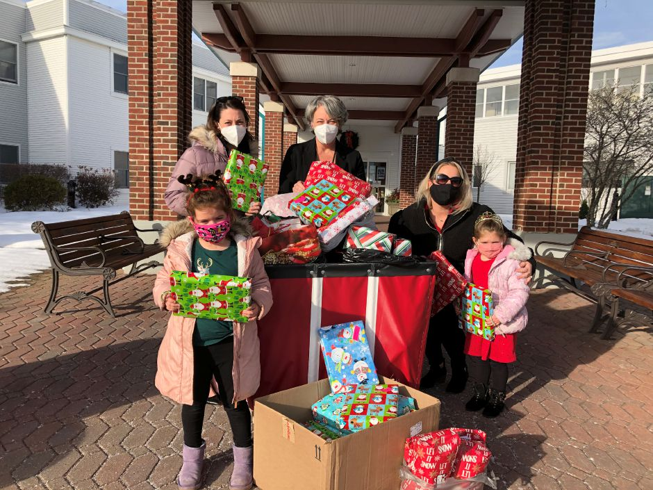 Back row, from left: Elim Park staff members accepting donated Christmas gifts are Sarah Mach and Beth Garrett. Bottom row:  Sydney Repko, age 6, Jessica Repko and Riley Repko, age 4. Submitted photo