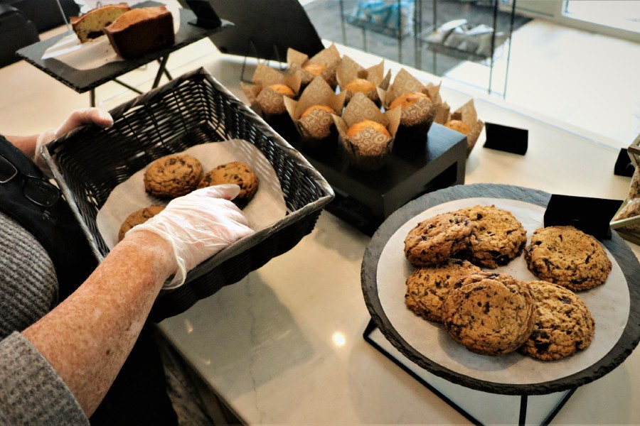 Baker Cas Cordova serves a batch of freshly-made cookies. Nadya Korytnikova, Record-Journal.