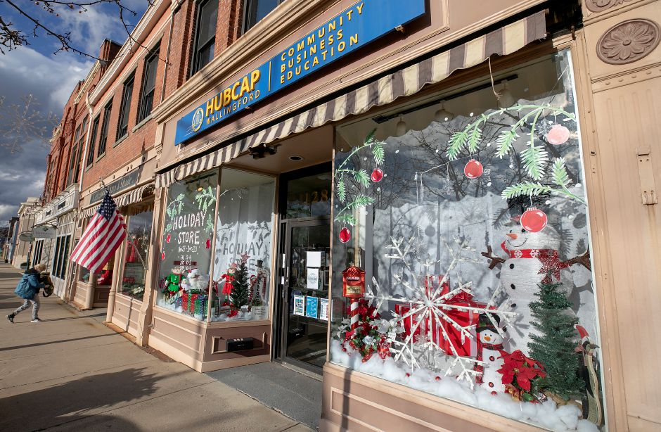 "The front windows of Hubcap decorated for the holidays on Center Street in Wallingford, Tues., Dec. 1, 2020. Downtown Wallingford will be filled with lights and holiday decorations this weekend for the ""Santa Claus is Coming to Town"" car parade. Dave Zajac, Record-Journal"