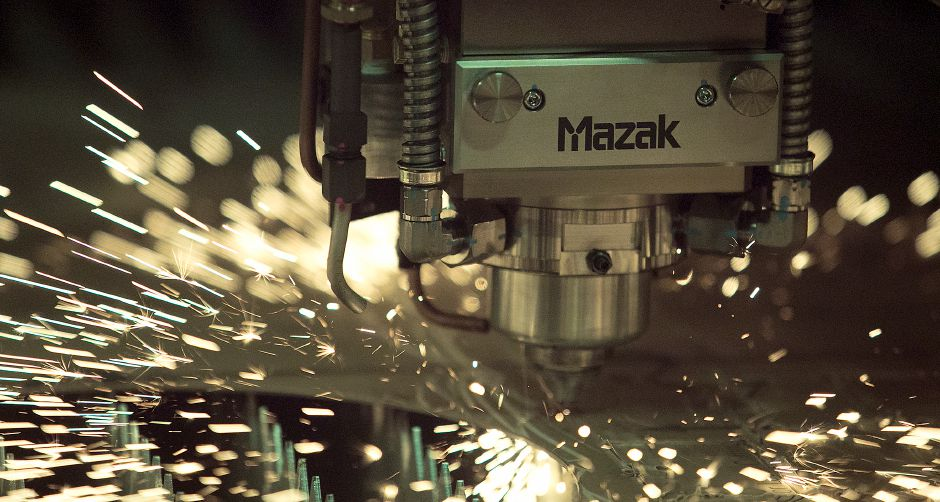 Sparks fly as a laser cuts through a steel plate on a Mazak machine at Logan Steel in Meriden, Monday, March 12, 2018. Industry reactions to President Trump's implementation of a 25 percent tarfff on steel imports and 10 percent on aluminum are mixed depending on the use and product. Dave Zajac, Record-Journal