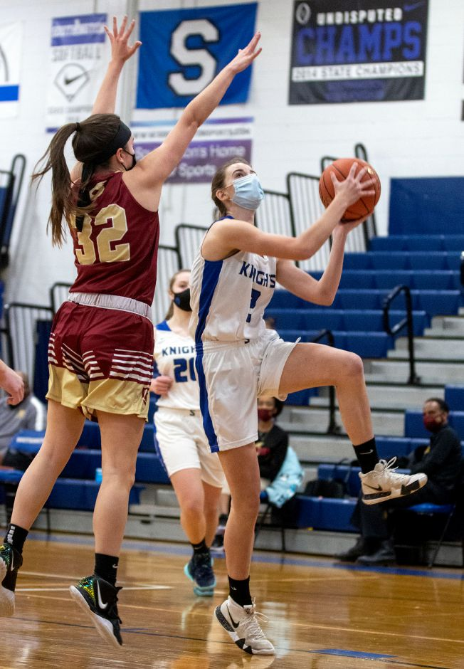 Southington's Taylor Sullivan goes for the layup around New Britain's Kaylee Cahill during the first half at Southington High School on Wednesday, Feb. 10, 2021. Aaron Flaum, Record-Journal
