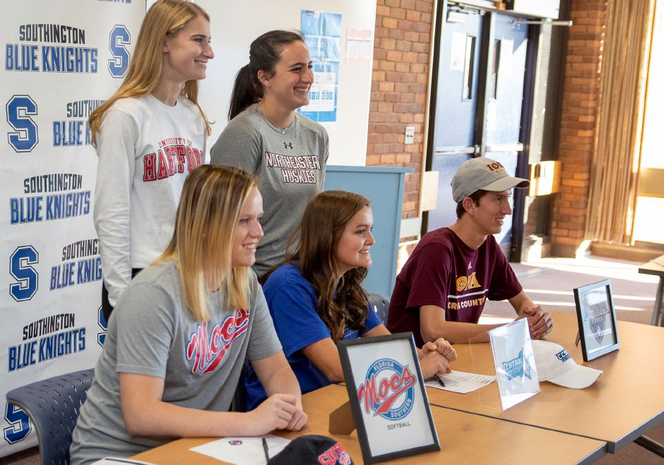 Southington High School held a ceremony on National Signing Day for its Division I commits. Signing National Letters of Intent in the school library were, seated left to right, Katie Gundersen, Katherine Crouse and Matthew Penna and, standing left to right, Sydney Garrison and Trinity Cardillo. Aaron Flaum, Record-Journal