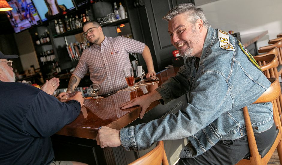 Rod Warner, of Durham, a patron of Horseshoe Taverne, talks about the new business at 100 New Haven Road in Durham on Monday. Photos by Dave Zajac, Record-Journal