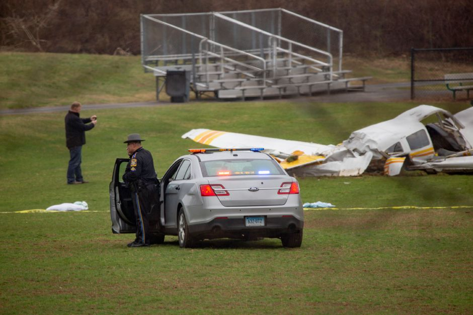 A Connecticut state trooper stands watch over the plane crash at Wilcox Technical High School Friday morning April 12, 2019. | Richie Rathsack, Record-Journal
