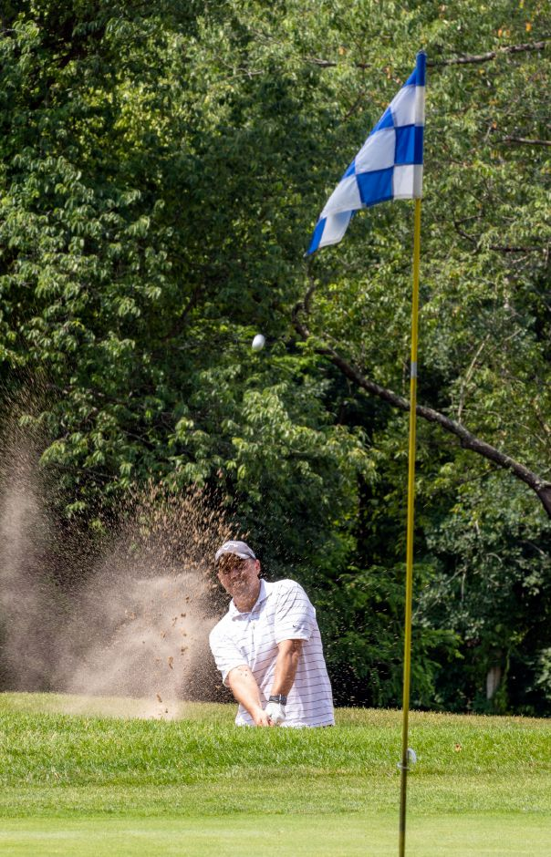 Doug Oliver of Newington hits out of the sand at the 7th hole at the Timberlin Golf Course in Berlin on Friday, July 3, 2020. The course is celebrating its 50th anniversary this year. Aaron Flaum, Record-Journal