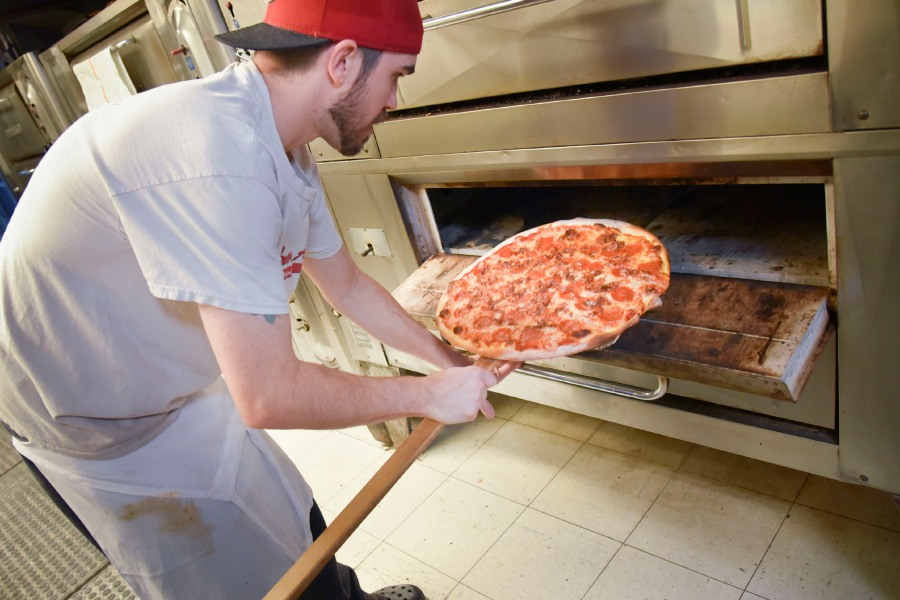 Amore Apizza owner Eddie Conniff makes pizza at his shop in Wallingford.  Bailey Wright, Record-Journal