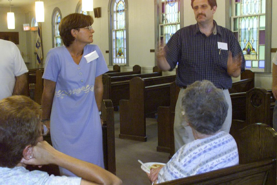 Rabbi John Nimon of Woodbridge spreaks with current and prospective members of Congregation Beth Isreal in Wallingord Sunday evening July 23, 2000, to Nimon