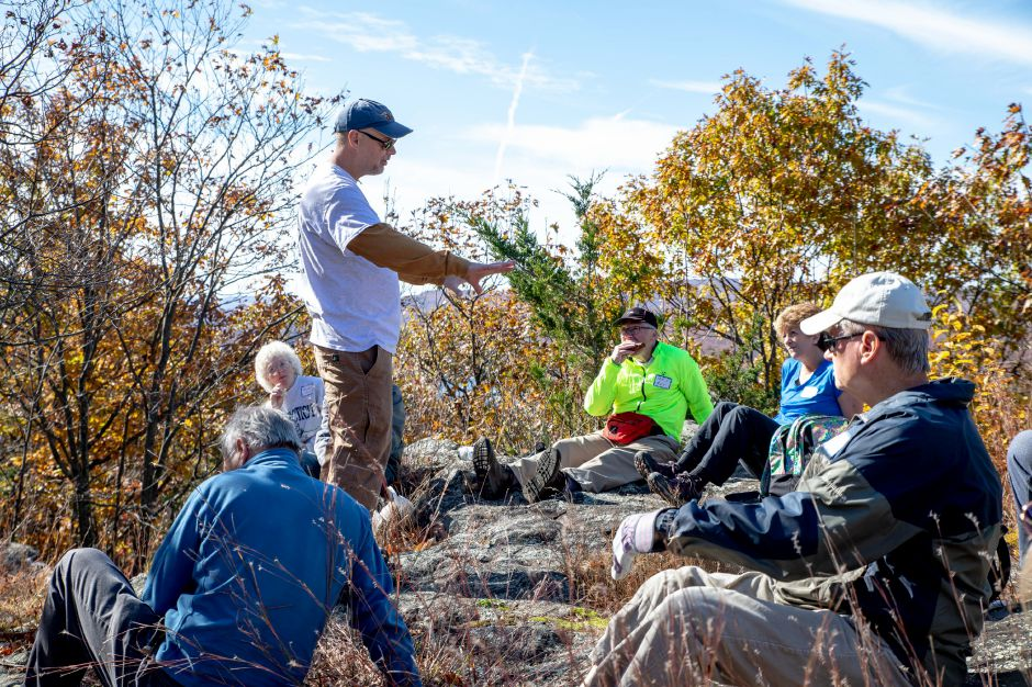 Berlin Land Trust member Raymond Archacki speaks to hikers who joined him on a hike to Mount Lamentation