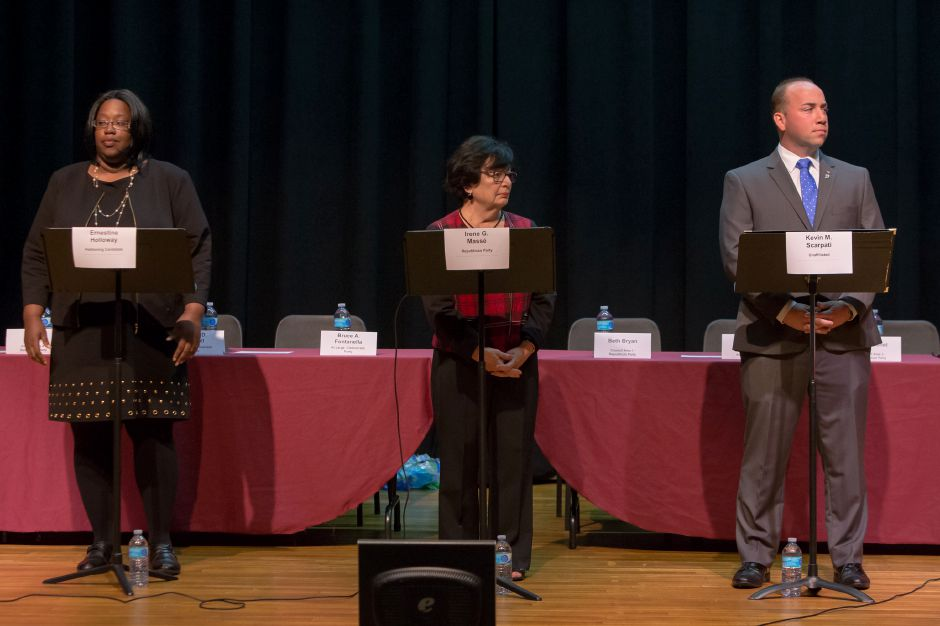 Ernestine Holloway left Irene Masse and Mayor Kevin Scarpati take their positions during a candidate forum at Washington Middle School in Meriden October 23, 2017 | Justin Weekes / For the Record-Journal