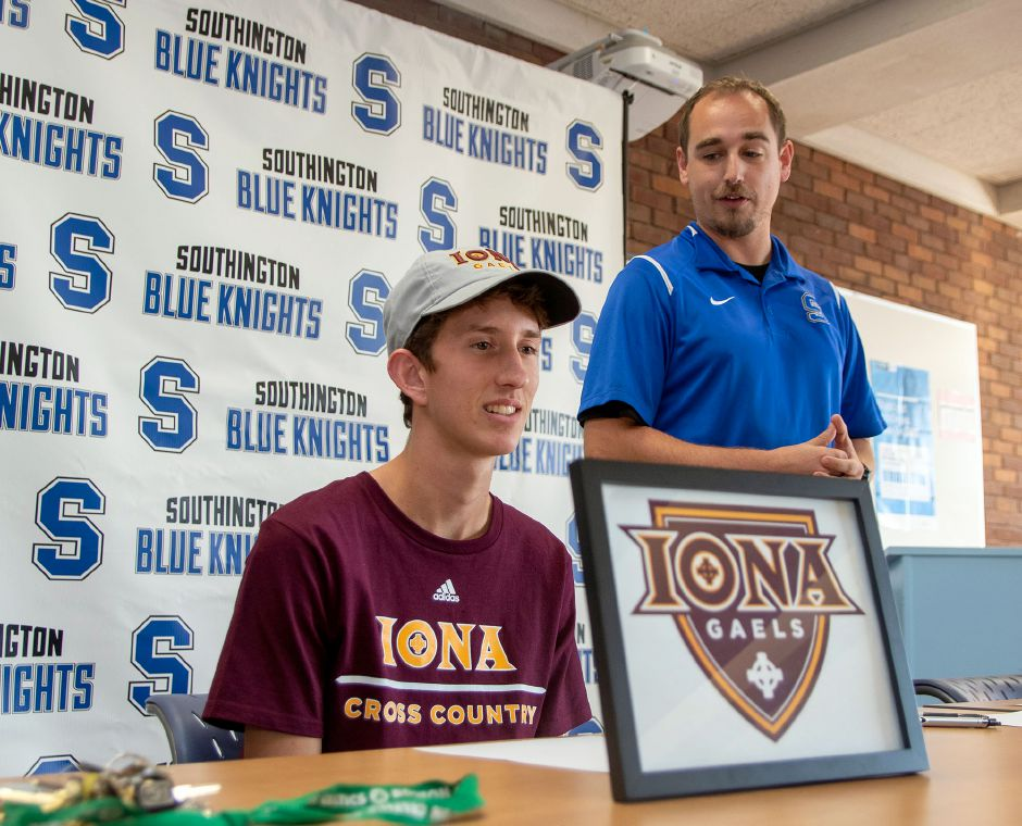 Southington High School cross country and track coach Connor Green talks about Matt Penna during Wednesday's Signing Day ceremoney in the Southington High library. Penna signed a National Letter of Intent to run at Iona College. Aaron Flaum, Record-Journal
