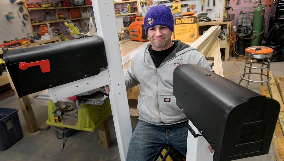 Gary Celella Jr., of Southington, has a patent pending for his plow-proof mailbox invention. The  hinged mailboxes bend or swing when force is applied. Celella, an electrician, is also owner of Dr. Kilowatt in Southington. Photos by Dave Zajac, Record-Journal