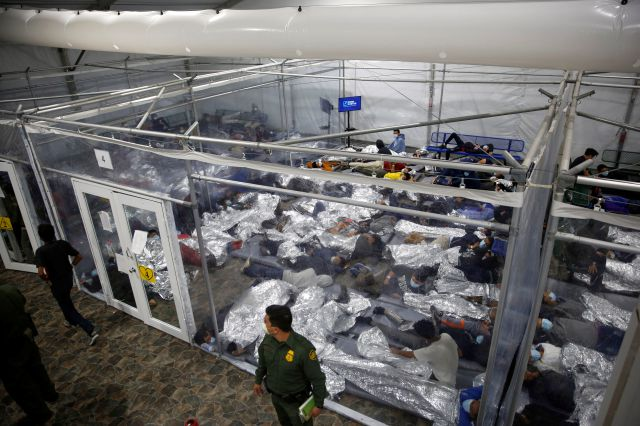 FILE - In this March 30, 2021, file photo, young minors lie inside a pod at the Donna Department of Homeland Security holding facility, the main detention center for unaccompanied children in the Rio Grande Valley run by U.S. Customs and Border Protection (CBP), in Donna, Texas. U.S. authorities say they picked up nearly 19,000 children traveling alone across the Mexican border in March. It
