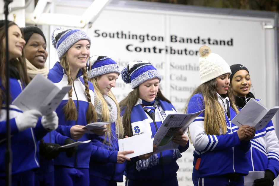 Members of the Southington High School cheerleaders sing Christmas carols during the annual Southington White Christmas in the Community event on Friday night, Dec. 6, 2019. Emily J. Tilley, special to the Record-Journal.