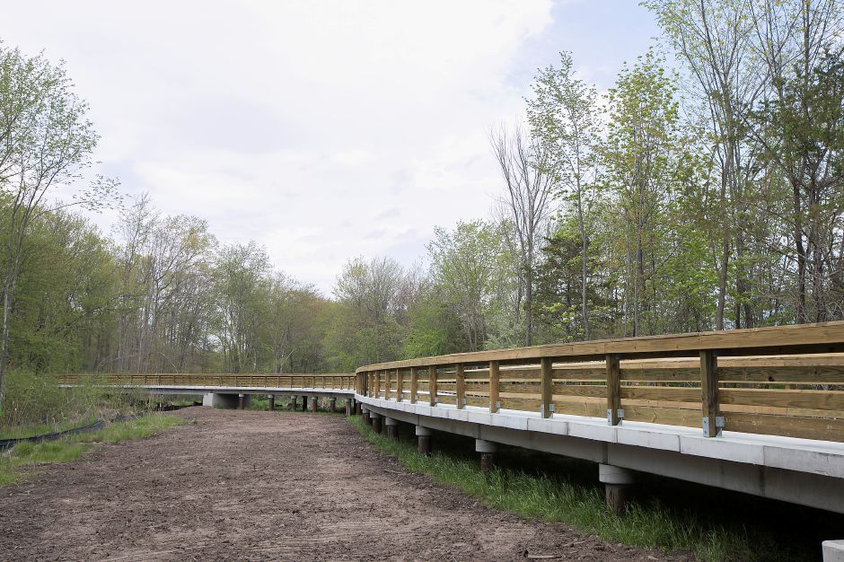 A bridge constructed on a new section of the Farmington Canal Heritage Trail between Cornwall Avenue and West Main Street in Cheshire, Thursday, May 10, 2018. Dave Zajac, Record-Journal