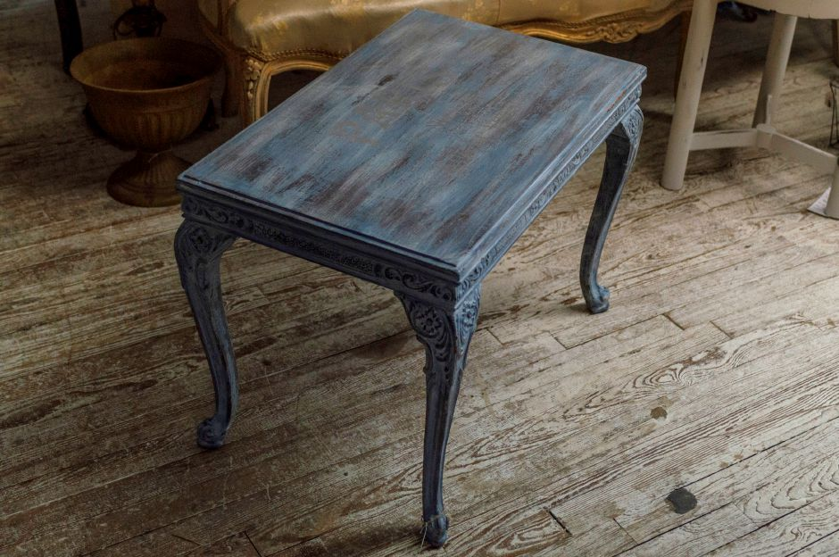 This small coffee table was refurbished using blue and grey paints with a grey transferred design on top. - at 2 Sister