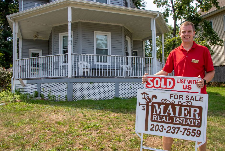 John Maier stands in front of a house Tuesday at 109 Ann St. in Meriden. It  recently sold. Aaron Flaum, Record-Journal