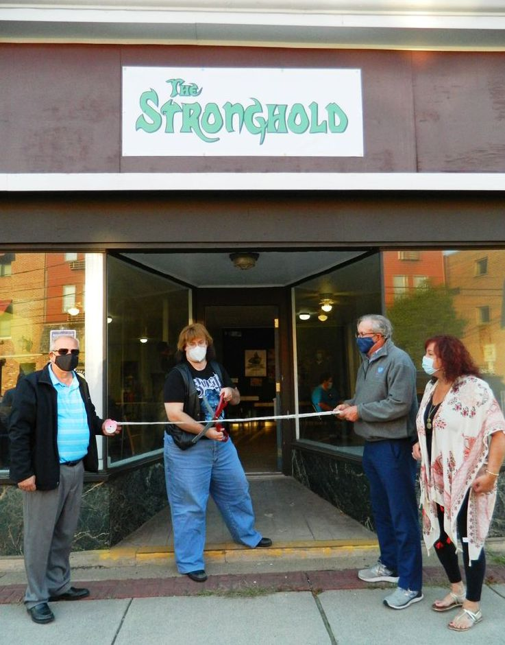 Pictured at The Stronghold, 13 Whiting St., are, from left: Plainville Chamber of Commerce President Jeff DiCosimo, Stronghold owner Brian Johnson, state Rep. Bill Petit and Plainville Chamber Membership Director Lisa Ouellette. Plainville Chamber of Commerce photo