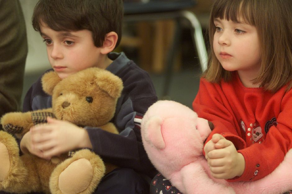 Stephen Munzi, left, and Amanda Chordas, left, hold their teddie bears during a math lesson Jan 25, 2001. The Parker Farms Elementary School kindergardeners were having a teddie bear week. They were writting about their bears, doing art projects, and measuring them as a math lesson.