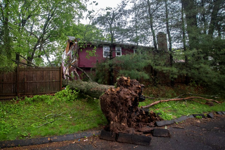 A tree crashed down against a home on Atkins Street in Meriden during the thunderstorm May 15, 2018. | Richie Rathsack, Record-Journal