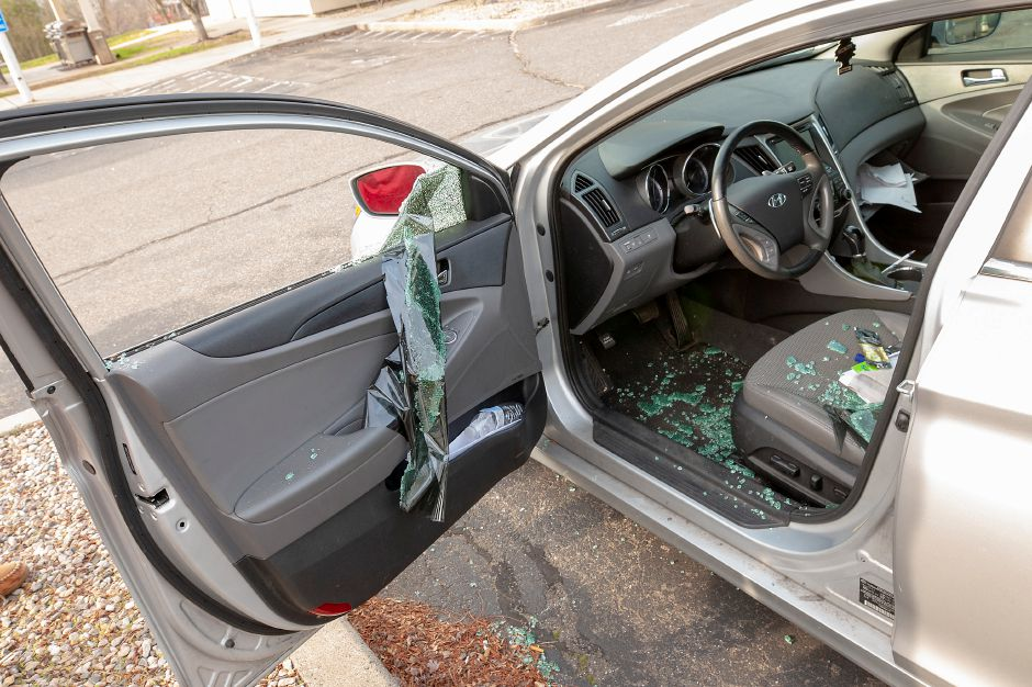 The Southington Town Council passed a resolution Monday calling for changes in state policy to address the rise in car thefts and burglaries locally. The smashed window of a vehicle broken into at a Meriden hotel can be seen in this photo from December. File photo, Record-Journal