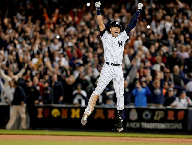 Derek Jeter jumps after hitting the game-winning single against the Orioles in the ninth inning of a Sept. 25, 2014, game in New York. Associated Press