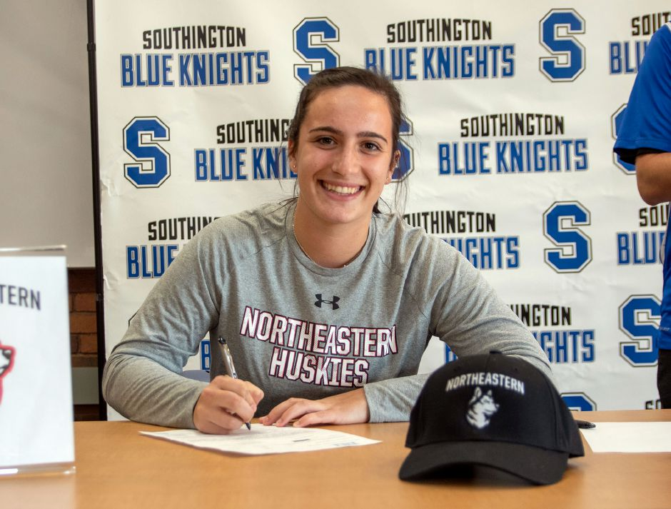 Southington High School's Trinity Cardillo signs a letter of intent to Northeastern University during a signing ceremony at the Southington Library on Wednesday, Nov. 13, 2019. Aaron Flaum, Record-Journal