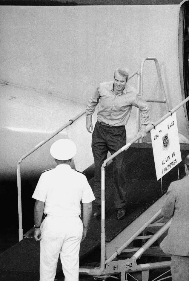 LCDR John S. Mccain III smilingly limps down ramp for welcoming on arrival, Wednesday, March 14,1973 from Hanoi. John is son of ADM. Mccain who directed vietnam war. (AP Photo)