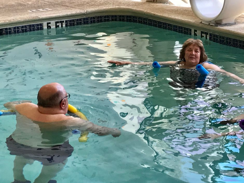 Instructor Phyllis Drescher talks with Larry Kozlowski, a participant in the Parkinson's aquatic exercise class in the therapy pool at the Wallingford YMCA, 81 S. Elm St., Wallingford. |Ashley Kus, Record-Journal