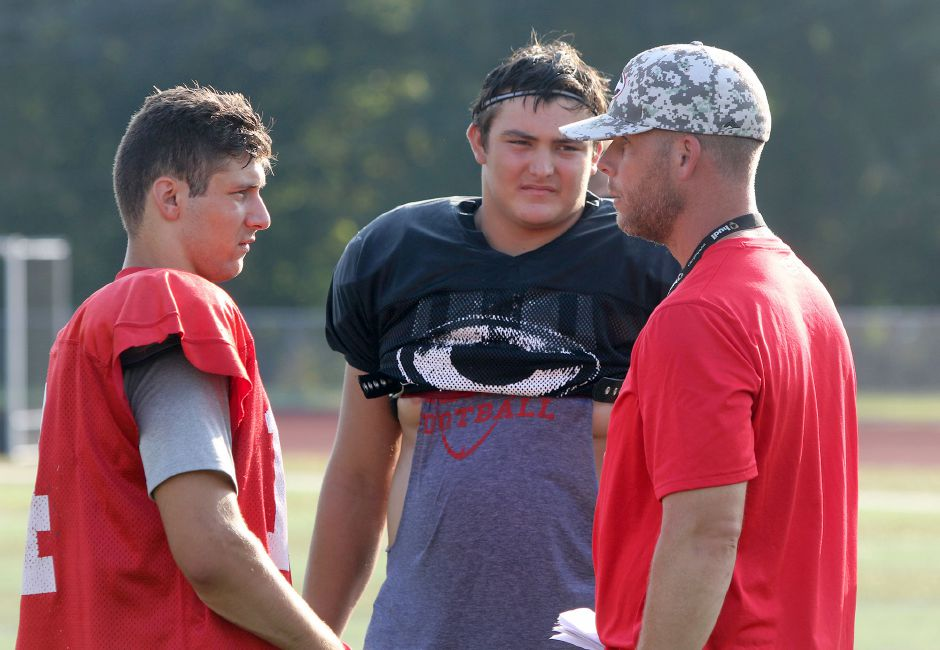 Will Bergin, center, was a two-time captain along with Jason Shumilla, left, for Cheshire High football coach Don Drust, right. Aaron Flaum, Record-Journal