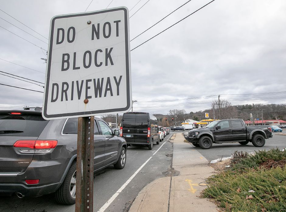 A motorist waits to pull out of the Plan B Burger parking lot as stopped traffic on Spring Street blocks the driveway, Tues., Jan. 28, 2020. Dave Zajac, Record-Journal
