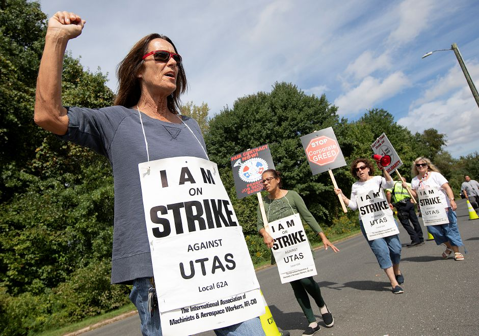 Lori Cosgrove, of Naugatuck, left, chants with other employees of UTC Aerospace Systems while walking the picket line in front of the business on Knotter Drive in Cheshire, Monday, Sept. 17, 2018. Cosgrove has been employed by the company for 44 years. Dave Zajac, Record-Journal