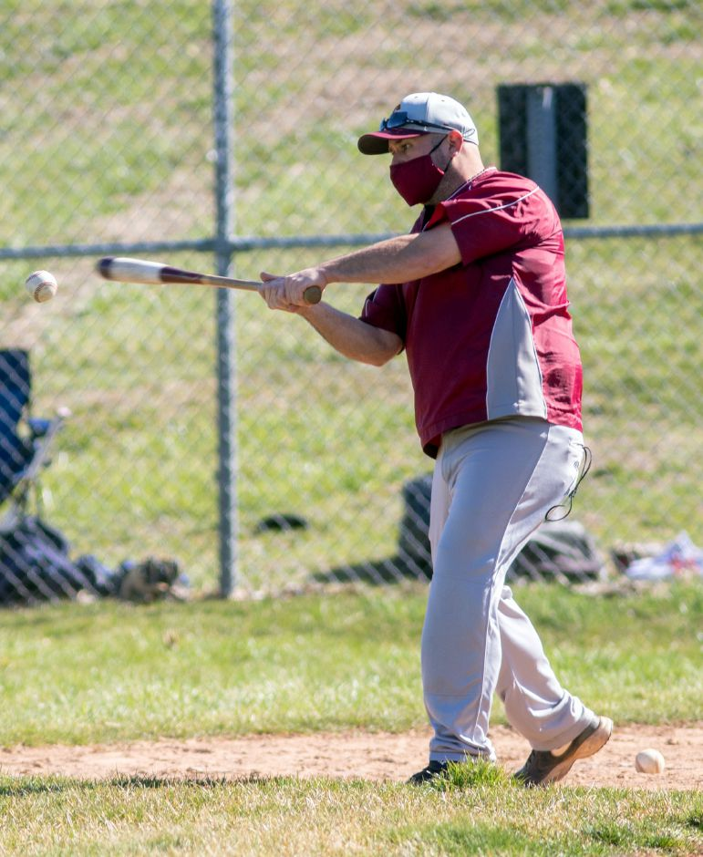 Sheehan's new head baseball coach Dom Lombardozzi hits balls to his infield during the warm-up before a scrimmage against Newington at Sheehan High School on Tuesday, March 6, 2021. Aaron Flaum, Record-Journal
