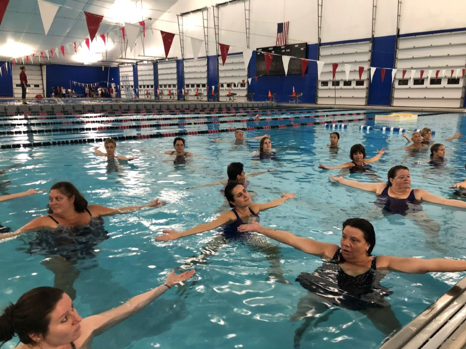 Yoga participants expand their arms in the water at the Cheshire Community Pool. |Kristen Dearborn, Special to Record-Journal