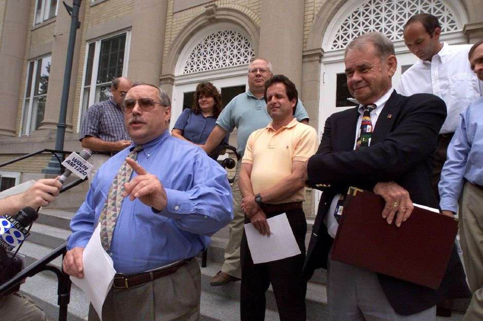 Wayne A. Gilbert, left, is the director of the Connecticut Independant Labor Union. He is speaking at a press conference on the steps of the Wallingford Town Hall Tuesday, July 25, 2000 announcing that negotiations between the mayor over the Martin Luther King Day as a paid holiday will go into binding arbitration.