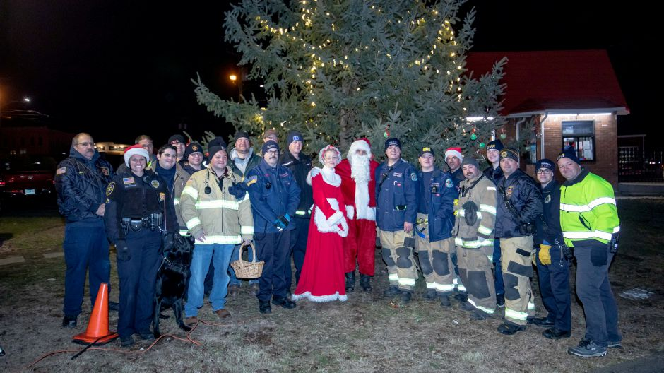 Berlin firefighters and police pose with Santa Claus and Mrs. Claus during the town