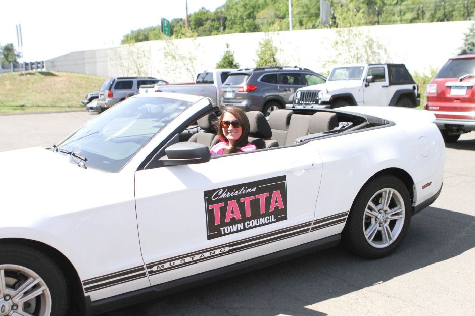 Christina Tatta in her convertible with campaign magnets at Community Day at Community Lake, Aug. 24, 2019. | Photo by Ray Ross, contributed by Christina Tatta