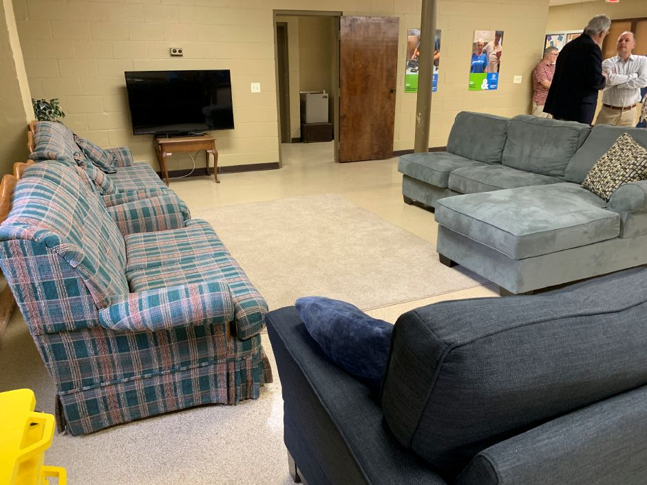 Couches for the club were donated by Froogle Furniture of North Haven. Photo by Everett Bishop, North Haven Citizen.