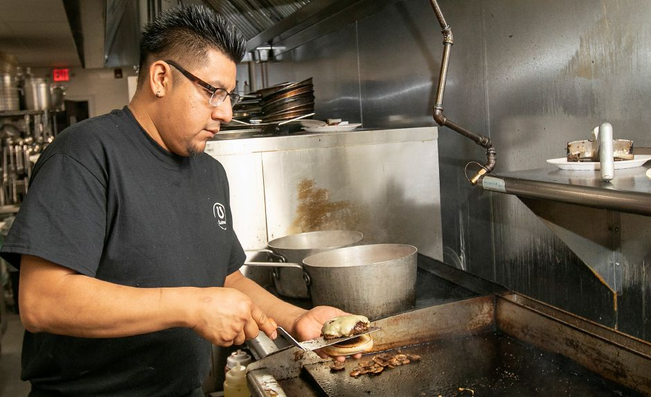 Chef Luis Lopez prepares a Shroomin burger at Horseshoe Taverne, 100 New Haven Rd., Durham, Mon., Jan. 6, 2020. Dave Zajac, Record-Journal
