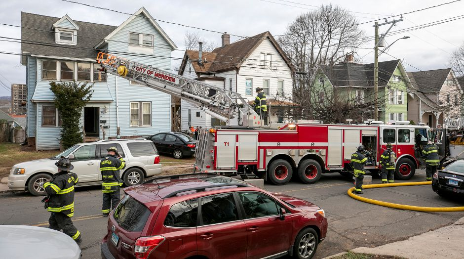 Meriden firefighters wrap up operations after a blaze at 94 Linsley Ave. in Meriden , Tues., Jan. 5, 2021. Dave Zajac, Record-Journal