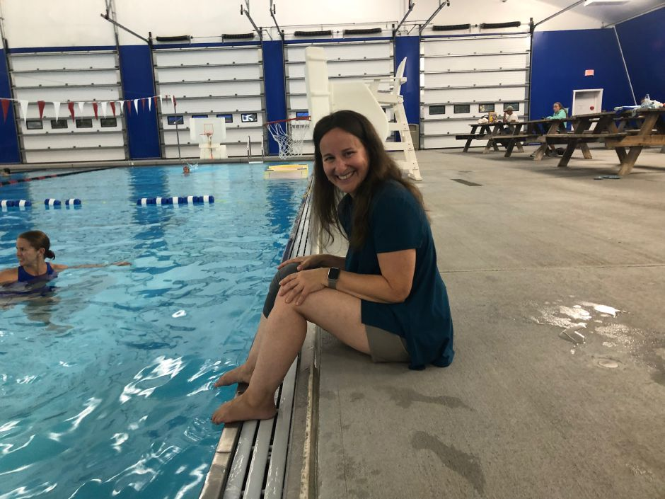 Lisa Cammuso sits at the edge of the pool before leading her first Yoga in the Water class at the Cheshire Community Pool. |Kristen Dearborn, Special to Record-Journal